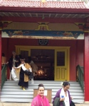 "Tibetan Temple in Wood Valley, following 11/11/11 ceremony. Kumu (~Teacher~) left ,in black & gold, coming down stairs. Me (center- in pink blessing scarf) after being anointed & blessed as a ""High Priestess,"" by Kumu with Pele's ashes & the sacred scarf . What a surreal experience & profound honor."